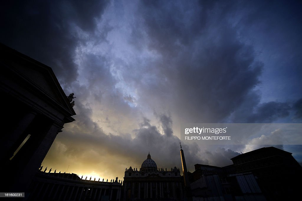 A view at dusk of St Peter's Basilica at the Vatican on Feburary 12, 2013, one day after it was announced that Pope Benedict XVI will resign. The Catholic Church entered uncharted waters the same day after Pope Benedict XVI's shock announcement the day before that he would become the first pontiff to resign in more than 700 years.