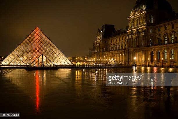 A view at night of the main entrance to the Louvre museum and its pyramid on March 24 2015 in Paris AFP PHOTO / JOEL SAGET