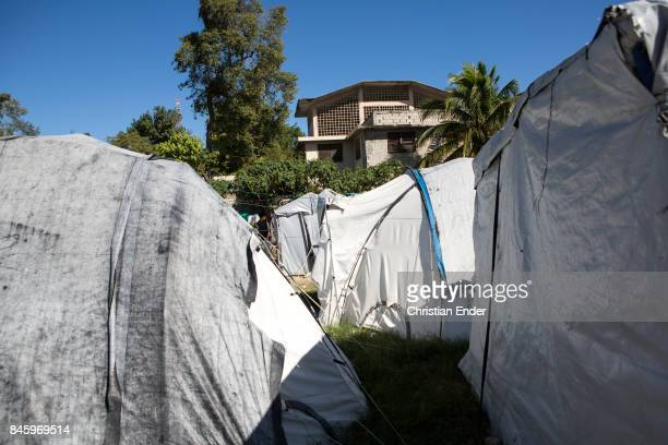 PortauPrince Haiti December 09 2012 View at several tents and a building in the background in the refugee camp Parc Colofe in PortauPrince The camp...