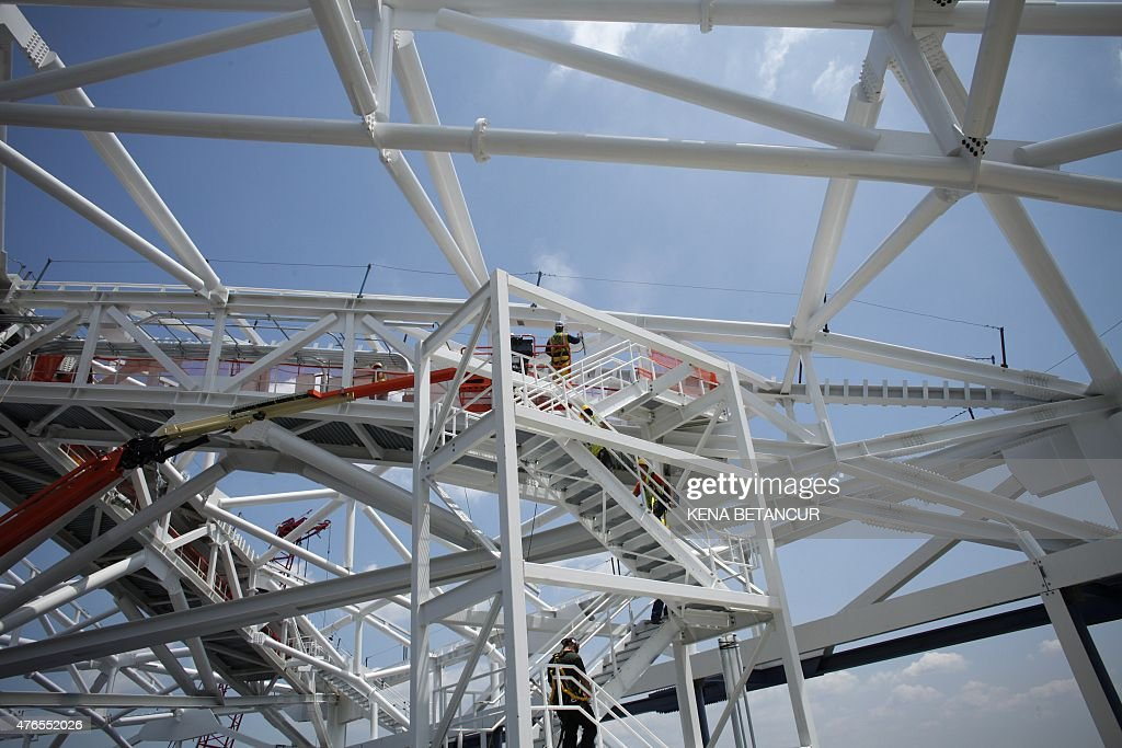 A view construction workers at the Arthur Ashe Stadium where the final piece of steel for the roof structure is being installed at the USTA Billie...