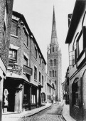 A view down a cobbled lane in Coventry towards the spire of the old St Michael's Cathedral 1866 Built in the late 14th and early 15th Centuries the...