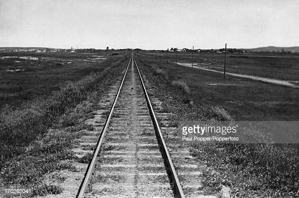A view down a section of the line on the TransSiberian Railway as it crosses the steppes near the border of the state of Manchukuo circa 1935