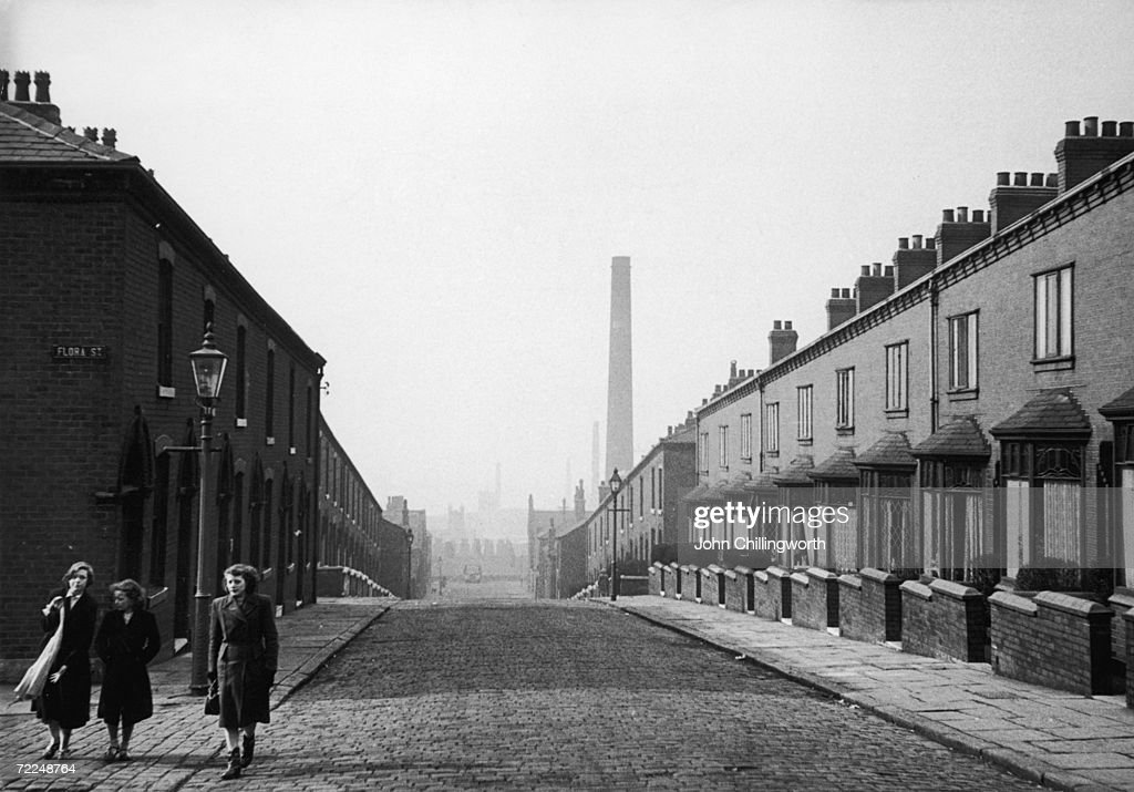 A view down a terraced street in Rochdale Lancashire April 1952 Original Publication Picture Post 5825 The Crisis In Cotton pub 1952