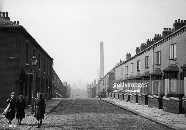 A view down a terraced street in Rochdale Lancashire April 1952 Original Publication Picture Post 5825 The Crisis In Cotton pub 1952