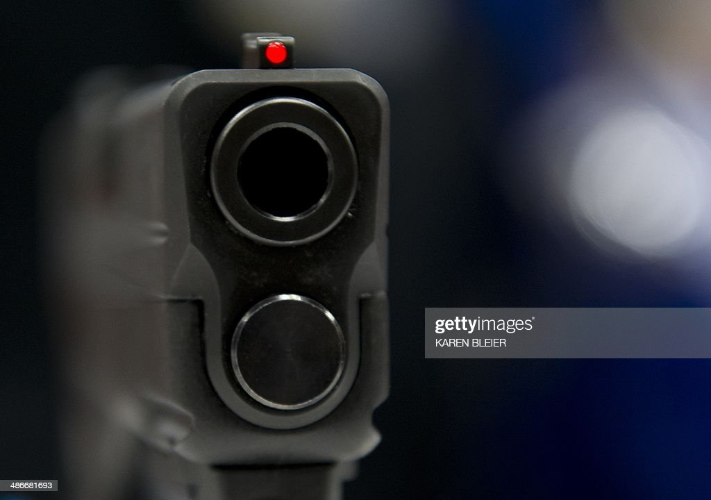 A view down the barrel of a semiautomatic handgun displayed at the143rd NRA Annual Meetings and Exhibits at the Indiana Convention Center in...