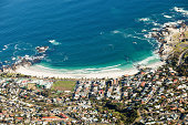 View down to beach of Camps Bay from top of Table Mountain, Cape Town, South Africa