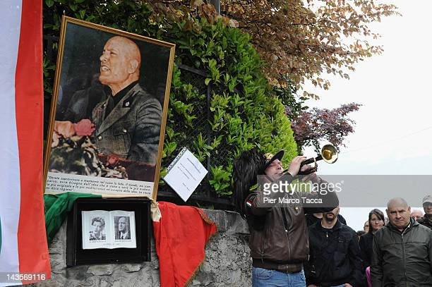 A view during the commemoration ceremony for the death of Italian dictator Benito Mussolini and his mistress Claretta Petacci in front of a headstone...