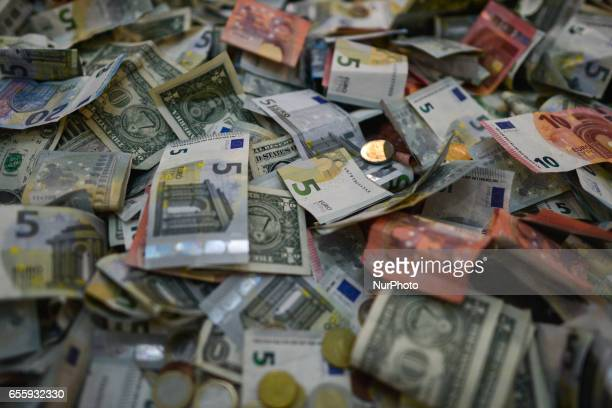 A view Euro and Dollar billets and coins on March 20 in Dublin Ireland White House press secretary Sean Spicer said in his interview with the Sunday...