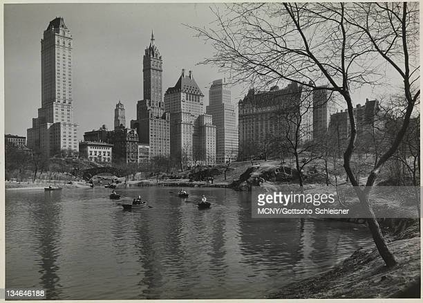 View facing southeast from Central Park The pond at the southeast corner of the park with rowboats and the Gapstow Bridge are visible in the...
