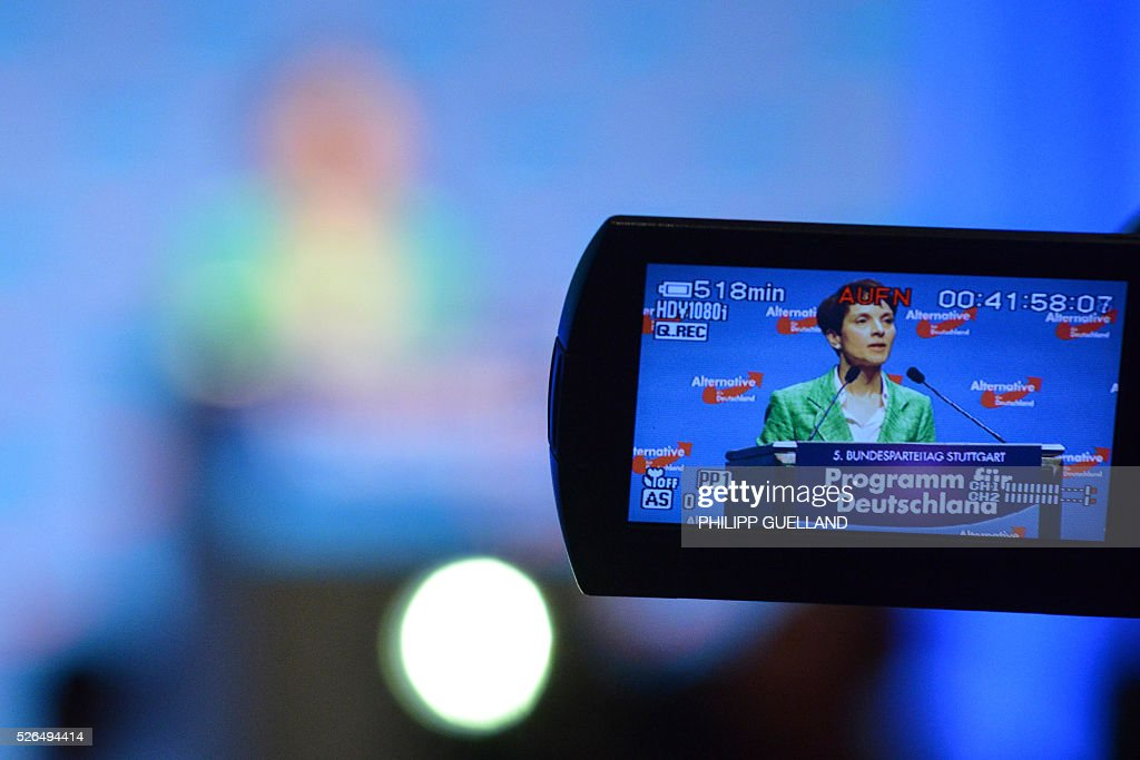 A view finder shows AFD party leader Frauke Petry delivering a speech during a party congress of the German right wing party AfD (Alternative fuer Deutschland) at the Stuttgart Congress Centre ICS on April 30, 2016 in Stuttgart, southern Germany. The Alternative for Germany (AfD) party is meeting in the western city of Stuttgart, where it is expected to adopt an anti-Islamic manifesto, emboldened by the rise of European anti-migrant groups like Austria's Freedom Party. / AFP / Philipp GUELLAND