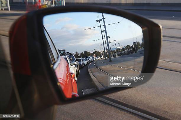 A view from a cars rear vision mirror of heavy traffic building up is seen before the train strike takes place on September 4 2015 in Melbourne...