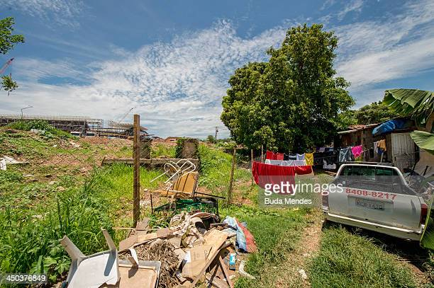 A view from a community bordering the construction site around the Arena Pantanal on November 17 2013 in Cuiaba Brazil Court cases are being fought...