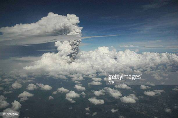 A view from a domestic flight from Denpasar to Yogyakarta that was subsequently diverted to Surabaya airport shows a plume of gas and ash billowing...