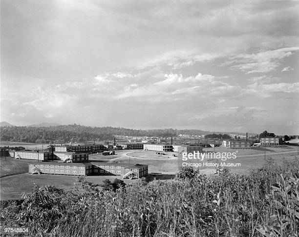 View from a hillside at a group of dormitory buildings in Oak Ridge Tennessee July 12 1944 Oak Ridge was established in 1942 to house the employees...