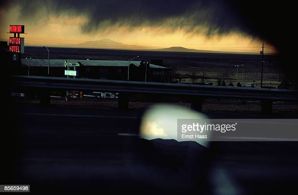 A view from a moving car as it passes the Western Skies Motel in stormy weather Colorado USA March 1977 Mountains can be seen reflected in the wing...