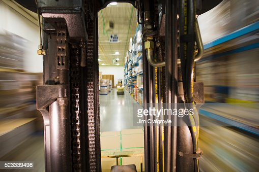View from a moving forklift in a warehouse