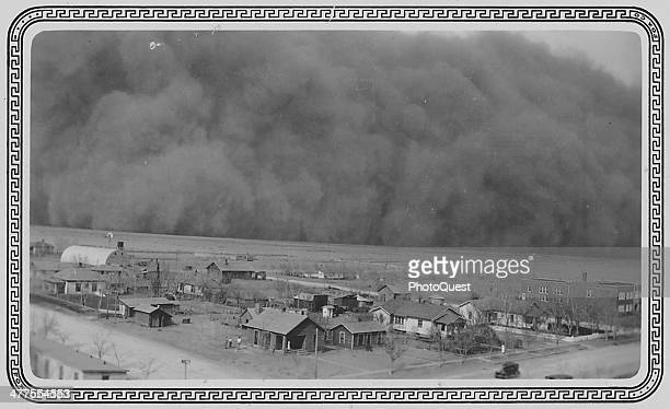 View from a one hundred foot tall water tower of a massive dust storm as it approaches town Rolla Kansas May 6 1935