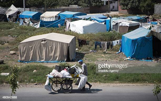 A view from a refugee settlement area with jerrybuilt tents and hovels in Yuregir district of Adana as they make preparations for the Eid alFitr...