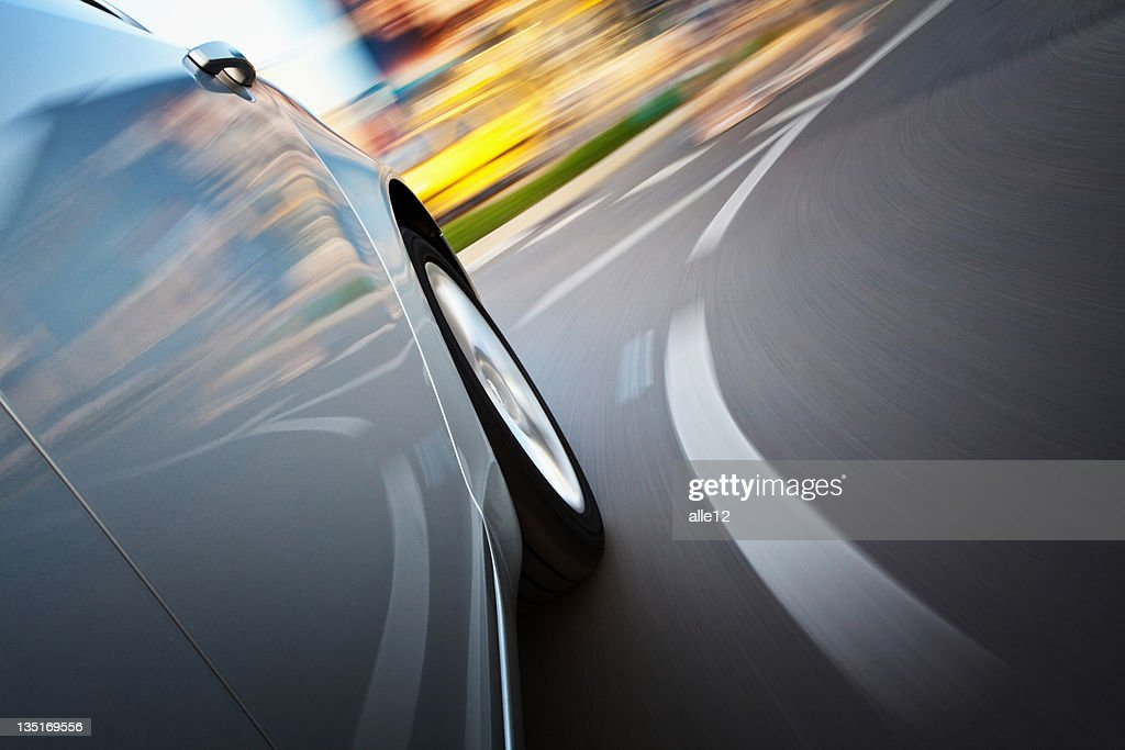 A view from a side of a car in motion