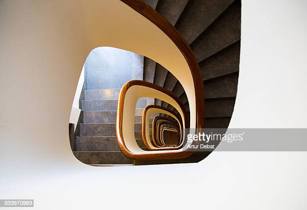 View from above of a white spiral stair inside a modern architecture building