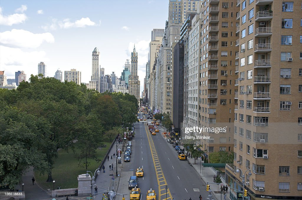 View from above of park, wide street and buildings : Stock Photo