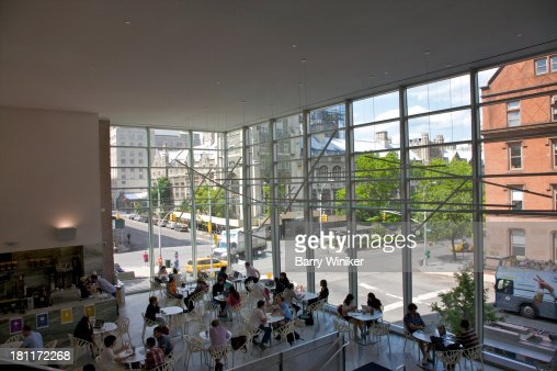 View from above of people in glas-walled cafe