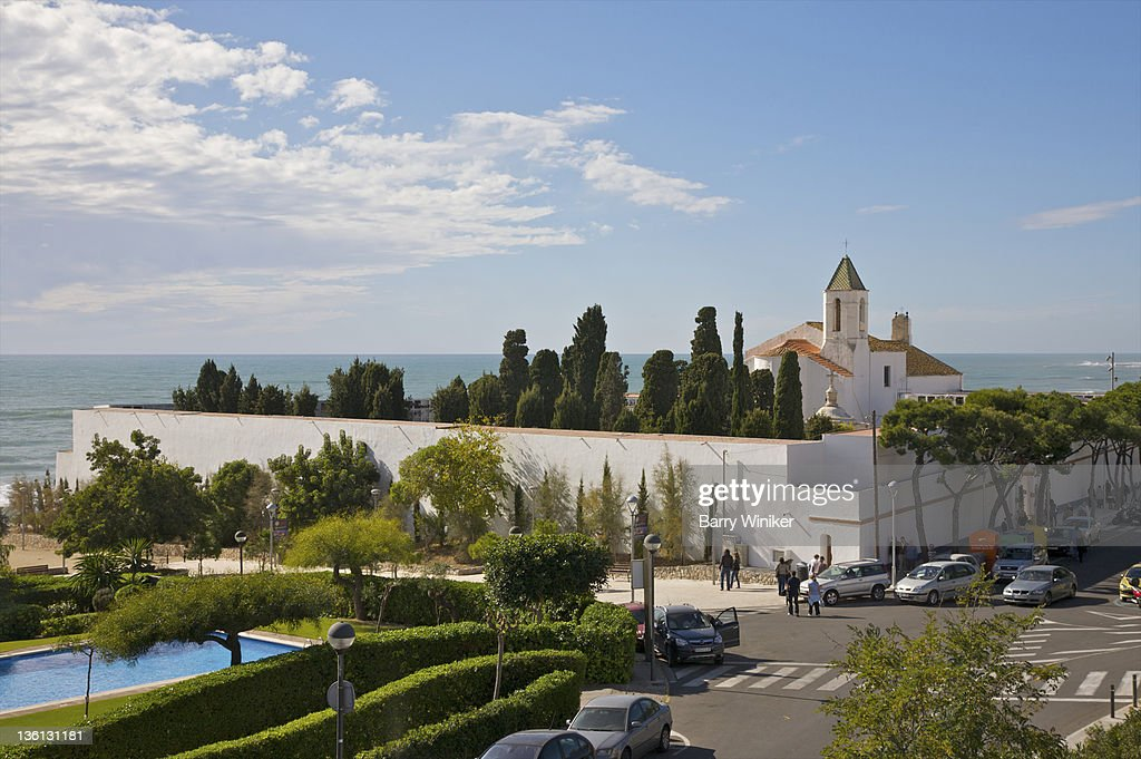 View from above of shrubs, trees, church and sea. : Stock Photo