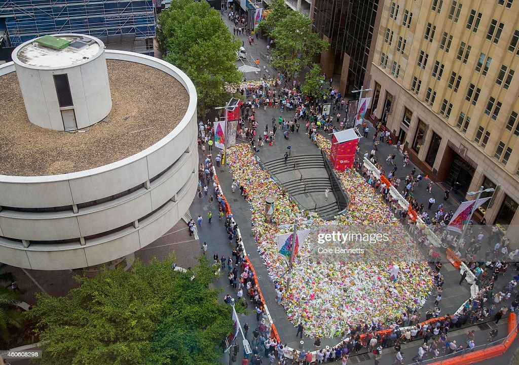 A view from above of thousands of floral tributes for deceased hostages Tori Johnson and Katrina Dawson in Martin Place on December 18 2014 in Sydney...