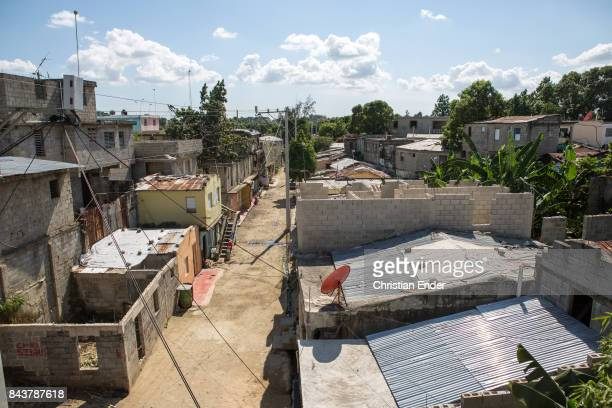 Santa Domingo Dominican Republic November 30 2012 View from above over the poor neighbourhood 'Los Alcarrizos' in Santa Domingo housings with tin...