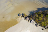 View from above, Stunning aerial view of a little hut on the beautiful Ao Nang Beach during low tide, Ao Nang, Krabi Province, Thailand.
