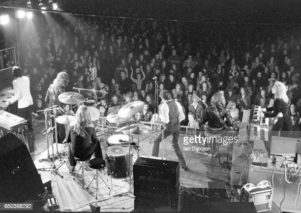 A view from above the back of the stage showing the band and the crowds in the audience as Roxy Music perform at De Montfort Hall Leicester United...