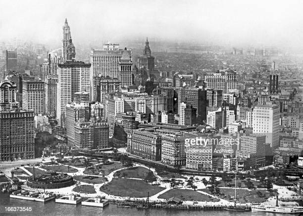 View from an airplane of the Battery in New York City with the Aquarium at left and the Singer Woolworth and Equitables Buildings on the skyline...