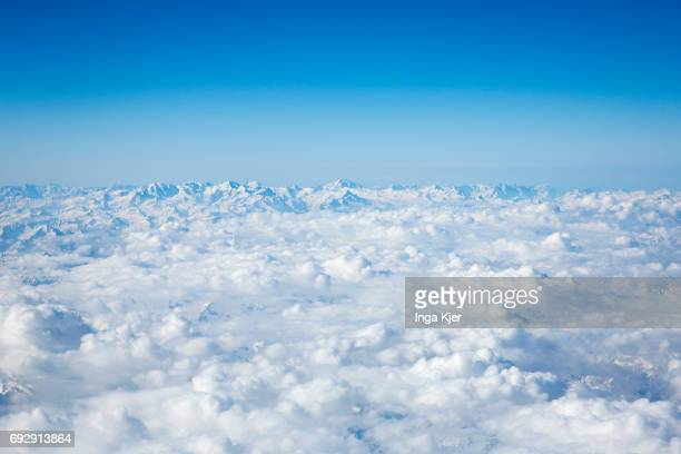 View from an airplane on the cloud cover over the Swiss Alps on April 10 2017 in Zurich Switzerland