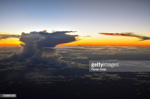 View from an airplane, sunset and clouds