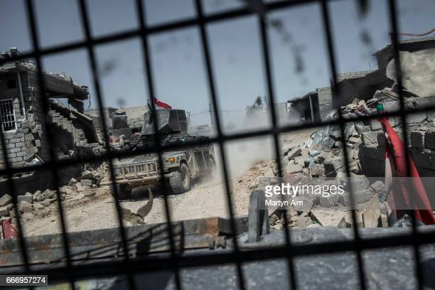 View from an Iraqi Counter Terrorism Service humvee in Al Yarmuk west Mosul April 10 2017 The ICTS retook the district Iraqi forces must fight...