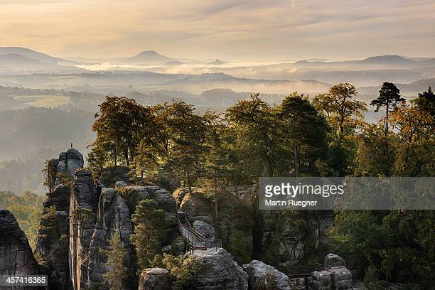 View from Bastei at sunrise with fog in the valley