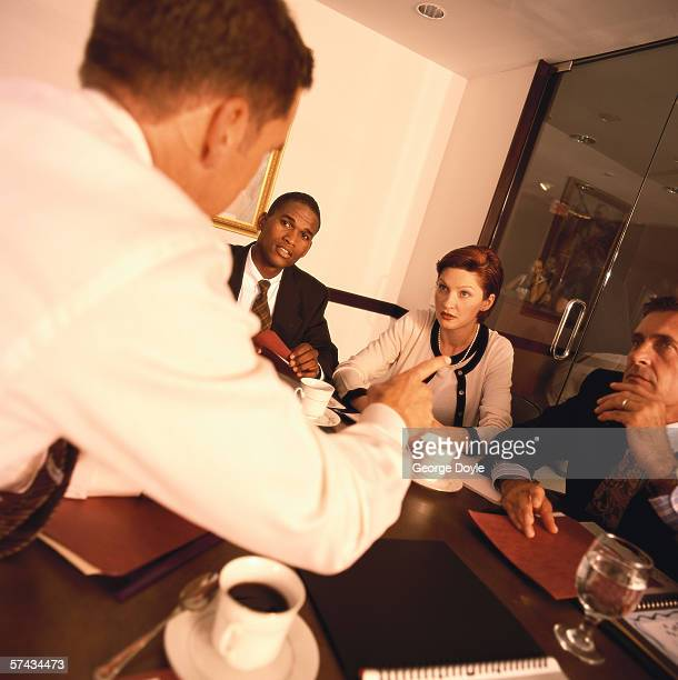 view from behind of a businessman conducting a meeting