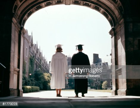 View From Behind Of Male And Female Graduates. : Stock Photo