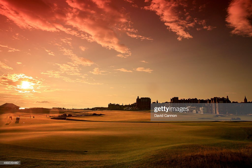 A view from behind the green on the par 4, first hole at sunrise on the Old Course at St Andrews venue for The Open Championship in 2015, on July 29, 2014 in St Andrews, Scotland.