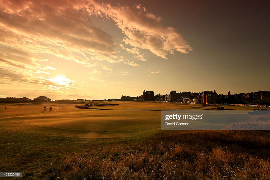 A view from behind the green on the par 4 first hole at sunrise on the Old Course at St Andrews venue for The Open Championship in 2015 on July 29...