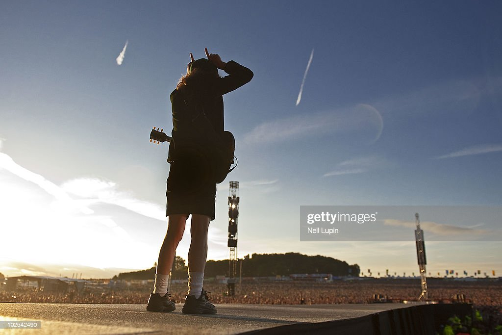 View from behind the stage of Angus Young of AC/DC performing on the first day of the Download Festival at Donington Park on June 11 2010 in Derby...