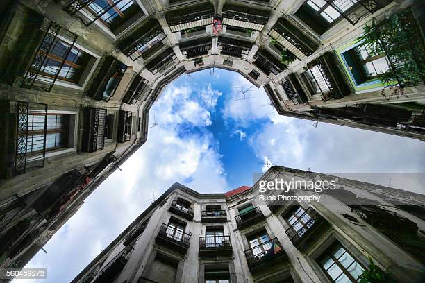 View from below of curved buildings, Barcelona