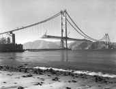 View from Crissy Field in the Presidio of the construction of the Golden Gate Bridge with the roadbed being installed San Francisco California 1937