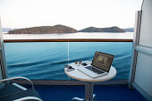 View from cruise ship with laptop on table, Alaska, USA