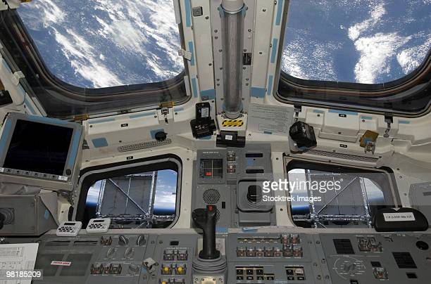A view from inside the flight deck of Space Shuttle Atlantis.
