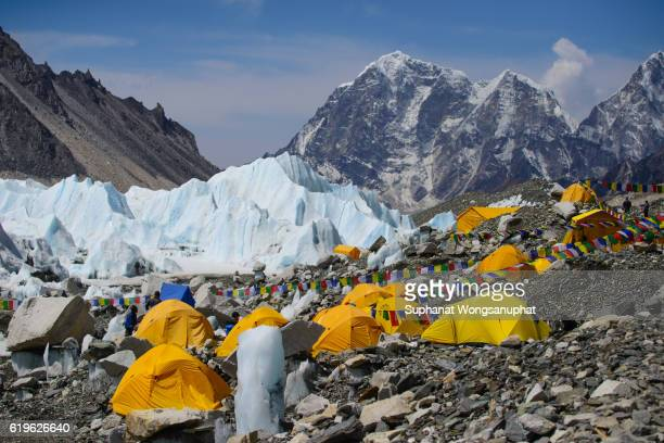 View from Mount Everest base camp, yellow tents and prayer flags trek to Everest base camp - Nepal