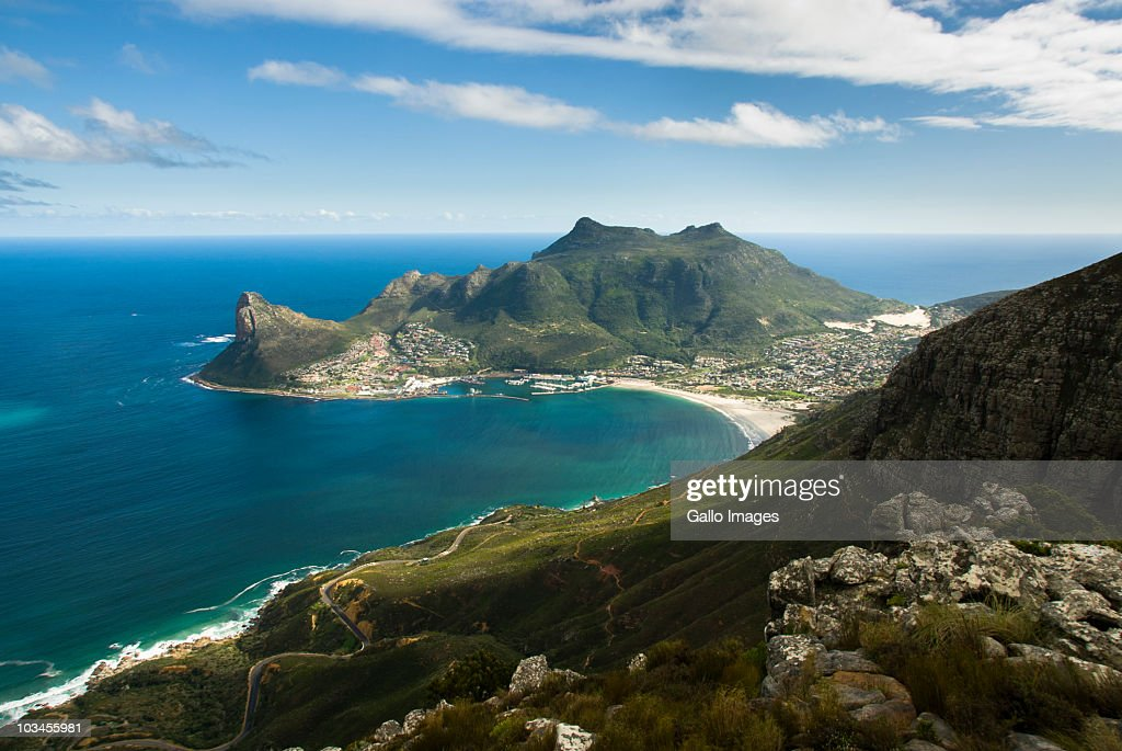 View from mountain of Hout Bay harbour and town below  Sentinel and Karbonkelberg Peaks, with coastal road running below.  Hout Bay, Cape Peninsula, Western Cape, South Africa : Stock Photo