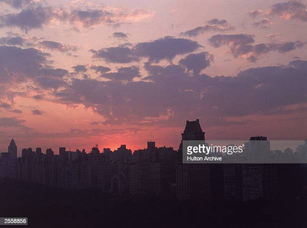 A view from over Central Park of the Midtown New York City skyline at dusk circa 1970