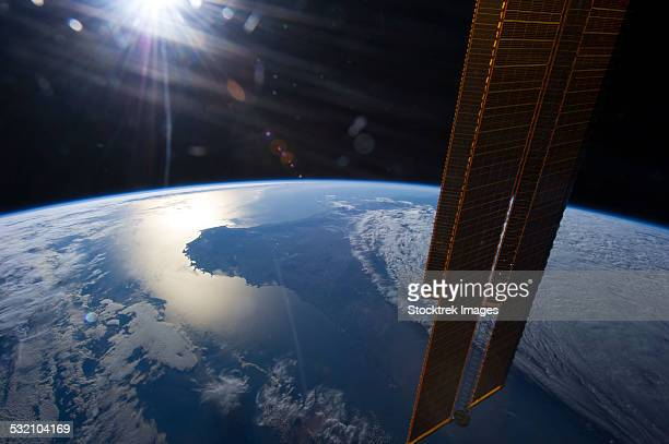 View from space of a setting Sun above part of southwestern Australia.