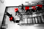 Medium group of people on an escalator viewed from a surveillance camera, some of them marked with red squares
